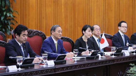 Thủ tướng Nhật Bản bắt đầu chuyến thăm chính thức Việt Nam ảnh 6