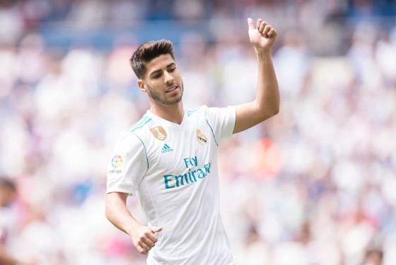Asensio đã gia hạn hợp đồng với Real. Ảnh: Getty Images