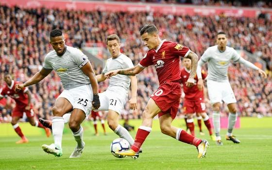 Liverpool (đỏ) chia điểm với Man.United. Ảnh: Getty Images