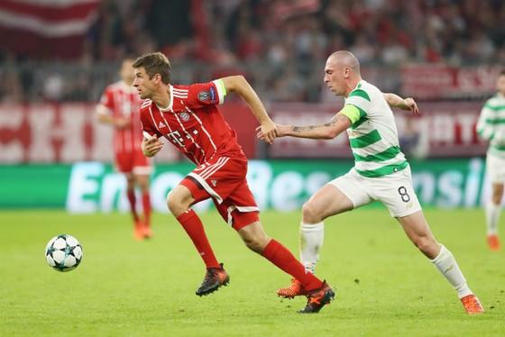 Thomas Mueller (trái) đã tìm lại được niềm vui trong thi đấu dưới sự dẫn dắt của HLV Jupp Heynckes. Ảnh: Getty Images