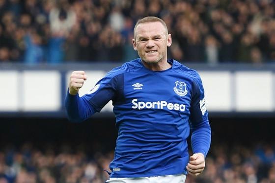 Wayne Rooney ăn mừng bàn thắng đẹp mở tỷ số. Ảnh: Getty Images