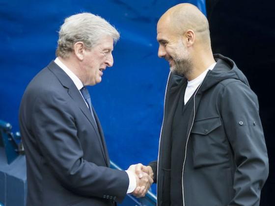 HLV Roy Hodgson (trái) tin tưởng Pep Guardiola và Man.City sẽ đăng quang. Ảnh: Getty Images