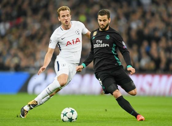 Harry Kane (trái) trong lần đối đầu Real Madrid ở Champions League mùa này. Ảnh: Getty Images