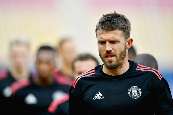 Michael Carrick hy vọng có thể bình phục và chơi những trận cuối cho Man.United. Ảnh: Getty Images