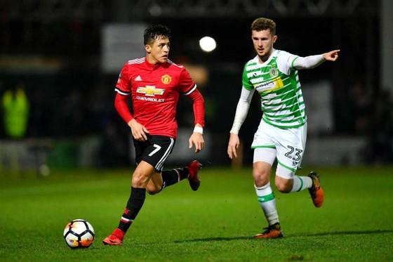 Alexis Sanchez (trái) đã có màn ra mắt ấn tượng cùng Man.United. Ảnh: Getty Images