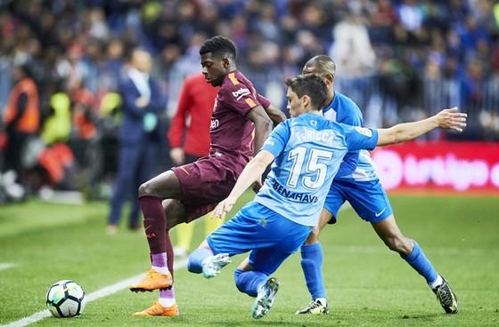 Dembele (nâu) đã có màn trình diễn xuất sắc trước Malaga.Ảnh: Getty Images.