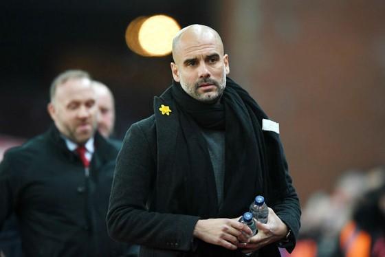 HLV Pep Guardiola quyết cùng Man.City quay trở lại thách thức ở mùa giải tới. Ảnh: Getty Images