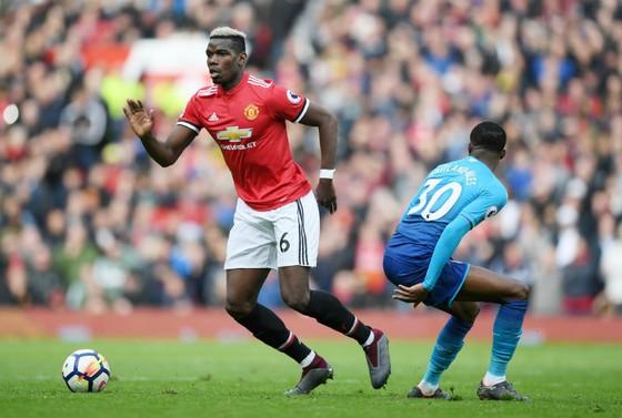 Paul Pogba (trái) thường xuyên chơi tốt trong vài trận gần đây. Ảnh: Getty Images