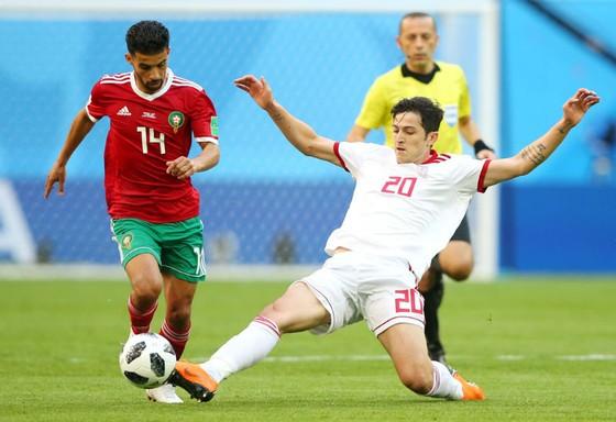 Morocco (trái) đã hứng chịu thất bại cay đắng  trong một diễn biến mà họ đã chơi tốt hơn so với Iran. Ảnh: Getty Images