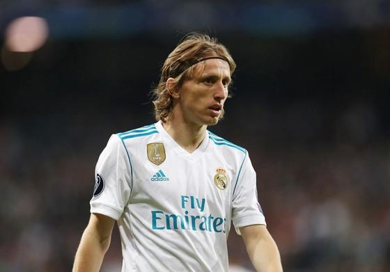 Modric dường như không thể cùng Real ra sân đối đầu với Atletico. Ảnh: Getty Images