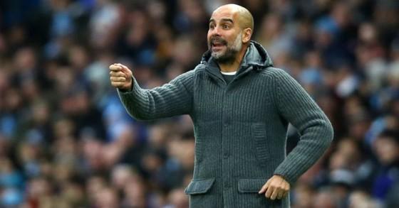 HLV Pep Guardiola tự tin về cách cầu thủ của ông đương đầu áp lực. Ảnh: Getty Images