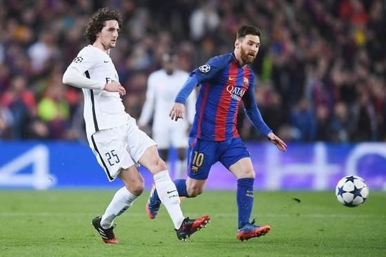 Adrien Rabiot (trái) sẽ là động đội của Lionel Messi mùa tới? Ảnh: Getty Images