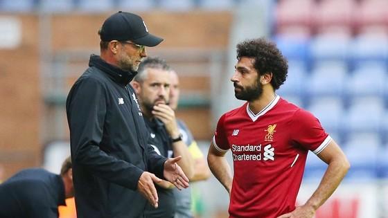 HLV Jurgen Klopp tin Liverpool đủ mạnh khi những ngôi sao như Mohamed Salah cam kết. Ảnh: Getty Images