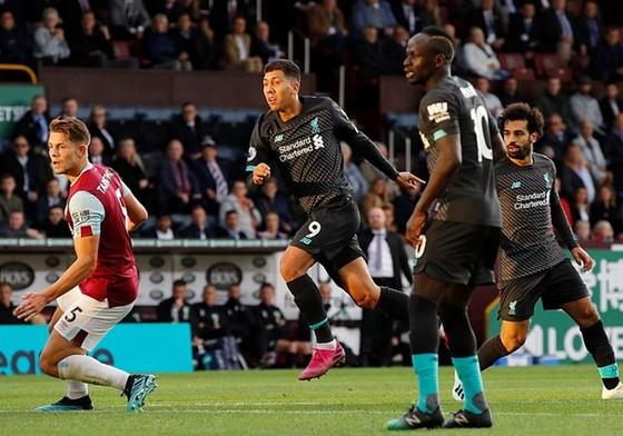 Roberto Firmino giúp Liverpool hoàn tất nhiến thắng và bản thân thiết lập mốc quan trọng. Ảnh: Getty Images