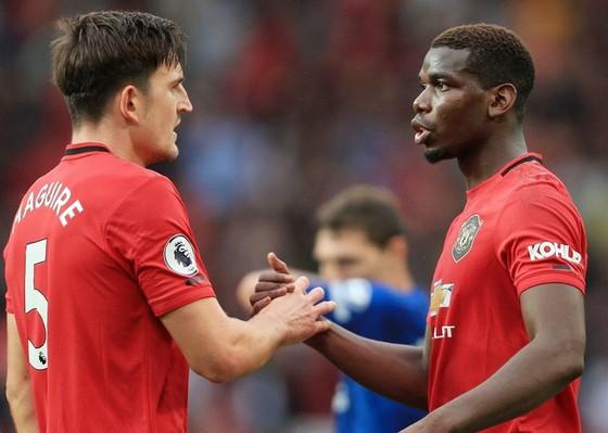 Trung vệ Harry Maguire (trái) và tiền vệ Paul Pogba đều là người đắt giá nhất trong vị trí của mình. Ảnh: Getty Images