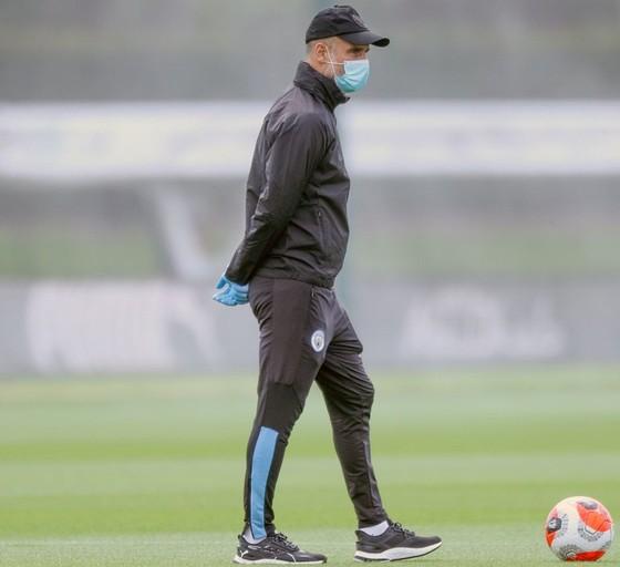 Guardiola trở lại trong thận trọng ảnh 1