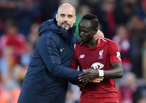 HLV Pep Guardiola khẳng định Liverpool xứng đáng để được tôn vinh. Ảnh: Getty Images
