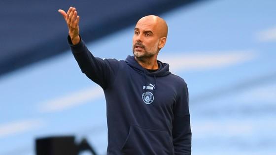 HLV Pep Guardiola từ chối cam kết tương lai của mình tại sân Etihad. Ảnh: Getty Images