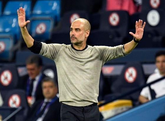 Pep Guardiola thận trọng nhắc nhở cầu thủ rằng nhiệm vụ mùa giải vẫn chưa hoàn thành. Ảnh: Getty Images