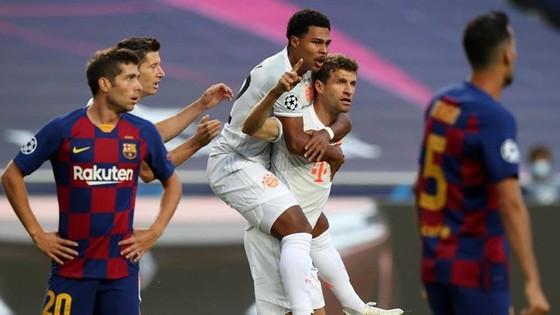 Thomas Mueller trở thành cầu thủ ghi nhiều bàn nhất vào lưới Barca ở Champions League. Ảnh: Getty Images