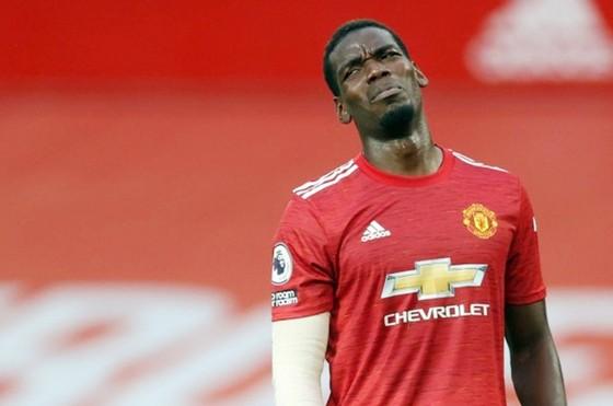Paul Pogba và dáng vẻ thất vọng trong thảm bại 1-6 trước Tottenham. Ảnh: Getty Images