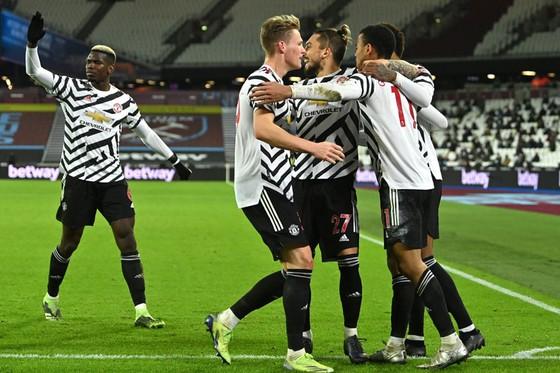 Man.United đã nối dài kỷ lục thắng sân khách để vào tốp 4. Ảnh: Getty Images