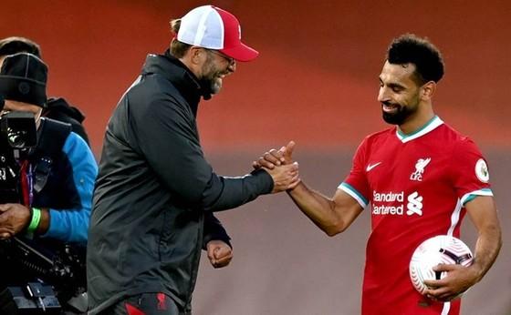HLV Jurgen Klopp khẳng định Mohamed Salah vẫn đanh hạnh phúc. Ảnh: Getty Images