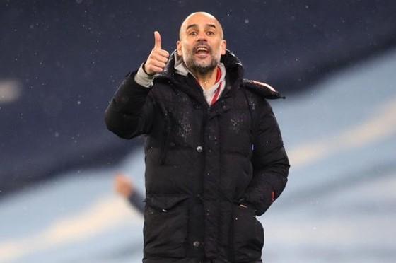 HLV Pep Guardiola hài lòng khi thấy lối chơi đã nhuần nhuyễn trở lại. Ảnh: Getty Images
