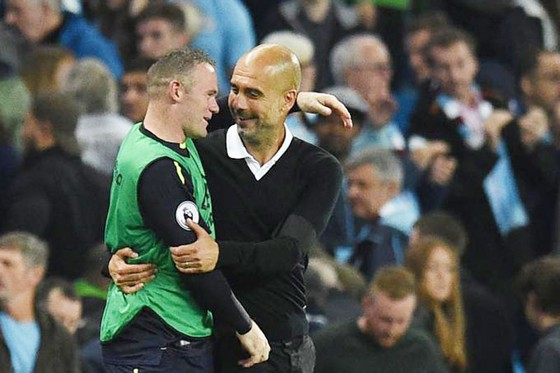 Rooney (trái) và Pep.