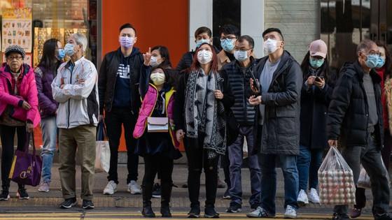 Dịch bệnh viêm phổi do virus corona: Virus có thể lây từ người sang người trong vòng 15 phút  ảnh 3