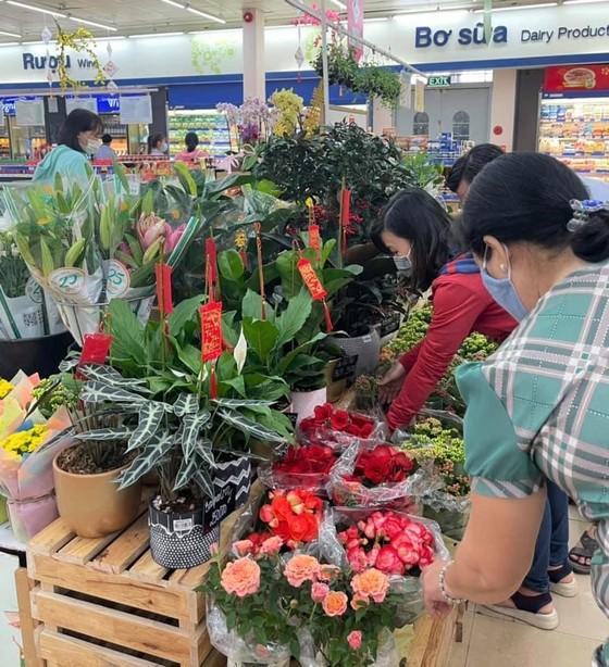 Hệ thống siêu thị Co.opmart, Co.opXtra mở cửa từ 7 giờ sáng phục vụ người dân mua sắm Tết ảnh 2