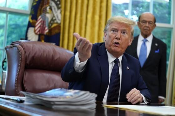 TT Trump de doa dung quan doi de 'ap dao' nguoi bieu tinh hinh anh 2 1000_Trum_Trump_AP.jpeg