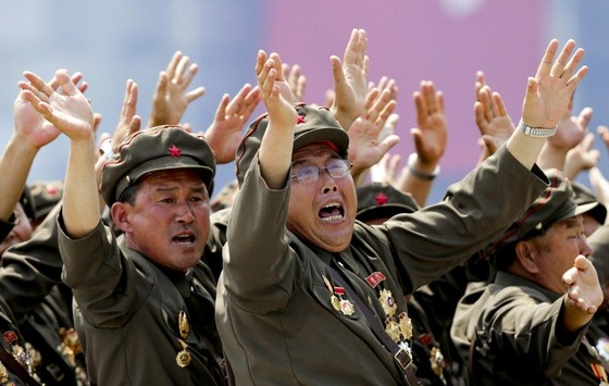 War veterans shout slogans to North Korean leader Kim Jong-un during a 2013 parade to mark the 60th anniversary of the signing of a truce in the Korean war. Photo: Reuters