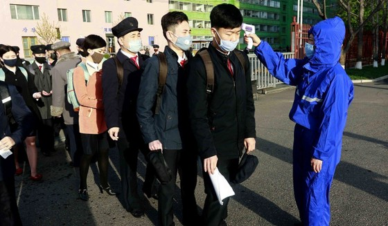 Students have their temperature checked at the Kim Chaek University of Technology in Pyongyang on April 22, 2020. Photo: AP
