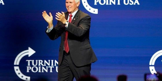 Vice President Mike Pence arrives on the stage before speaking at the Turning Point USA Student Action Summit, Tuesday, Dec. 22, 2020, in West Palm Beach, Fla. (AP Photo/Lynne Sladky)
