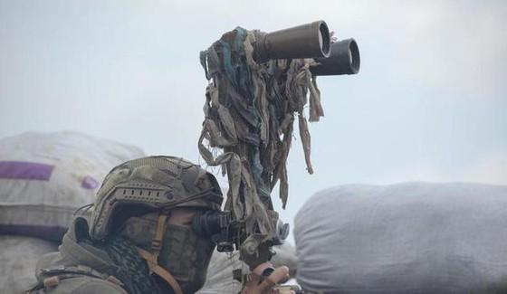 Ukraine bất ngờ tấn công dữ dội lực lượng dân quân miền Đông ảnh 7