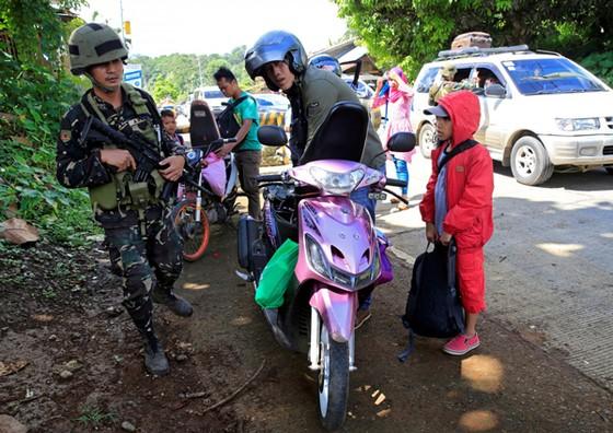 Phiến quân Maute bắt cóc con tin ở Marawi ảnh 1