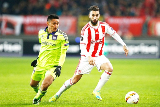 Phong độ ấn tượng của Partizan sẽ là thử thách không hề dễ dàng với Olympiakos (phải).