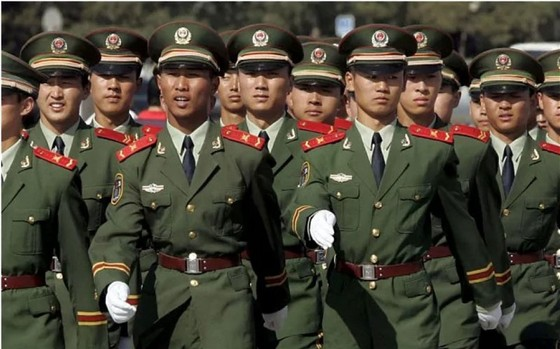 Trung Quốc xử lý nghiêm hành vi chống người thi hành công vụ ảnh 1