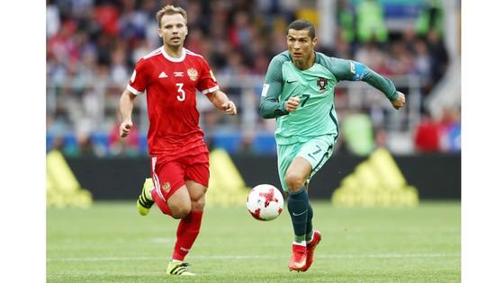 Một chiến thắng trước New Zealand đủ để Bồ Đào Nha (phải) thẳng tiến vào bán kết.