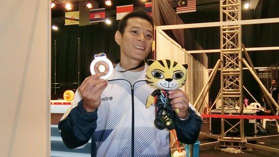 Thạch Kim Tuấn đoạt HCV cử tạ - hạng cân 56kg. Ảnh: DŨNG PHƯƠNG