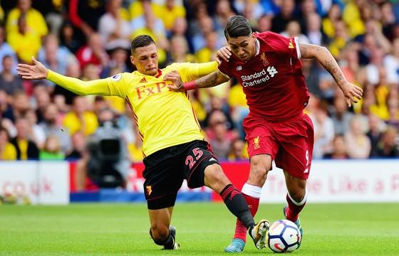 Liverpool (phải) sẽ có chuyến làm khách không hề dễ dàng trước Hoffenhieim
