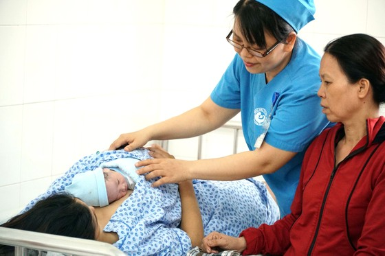 Thay đổi nhận thức về nuôi con bằng sữa mẹ ảnh 1