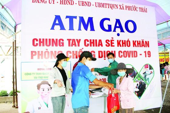 Vedan Việt Nam chung tay nhân rộng mô hình ATM gạo hỗ trợ đồng bào bị ảnh hưởng bởi dịch bệnh Covid-19 ảnh 1