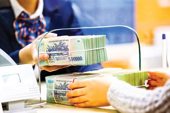 Kiểm soát chặt tín dụng vào bất động sản ảnh 1