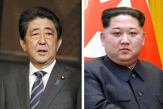 Thủ tướng Shinzo Abe và nhà lãnh đạo Kim Jong-un (Ảnh: Kyodo, Xinhua)