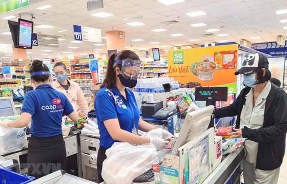 Nhu cầu nguồn nhân lực ở lĩnh vực thương mại gia tăng trong mùa dịch COVID-19. (Ảnh: Thanh Vũ/TTXVN)