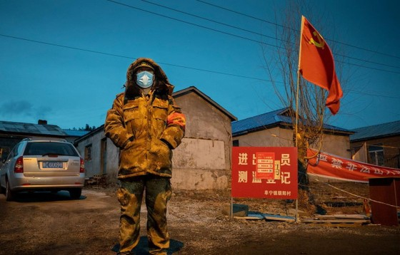 Thành phố Cáp Nhĩ Tân bị phong tỏa để ngăn chặn sự lây lan của dịch COVID-19. (Nguồn: AFP)