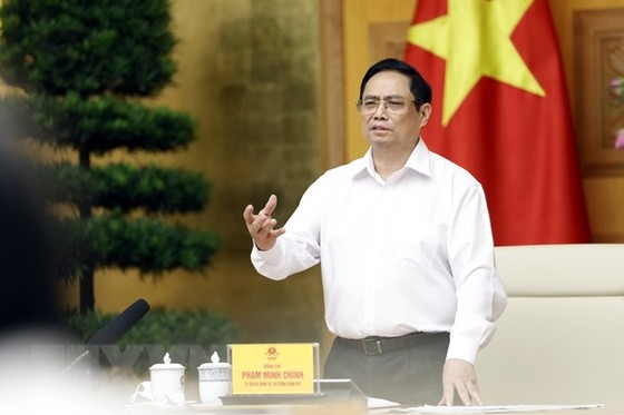Thu tuong: Tao moi dieu kien de som san xuat vaccine phong COVID-19 hinh anh 1