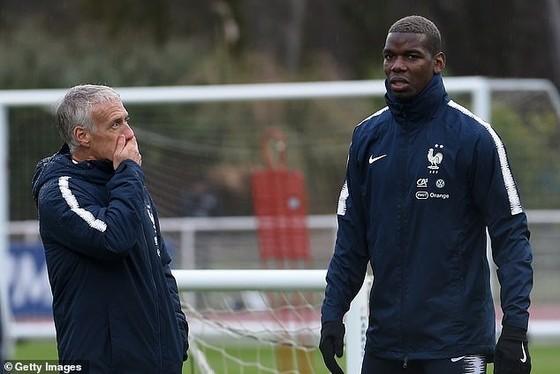 Didier Deschamps và Paul Pogba